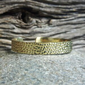 Golden hammered bangle bracelet