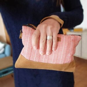 Worn ethic clutch bag
